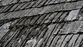 Old broken cedar wooden shake shingle roof of the house stock footage