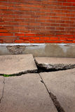 Old Broken Cement Cracked Sidewalk Brick Wall Stock Photography