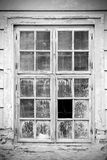 Old broken closed window in black and white Stock Photos