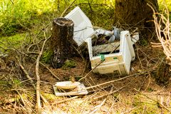 Old broken computer dumped in the woods Royalty Free Stock Photography