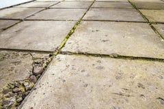 Old and broken cracked concrete floor tiles Stock Photos