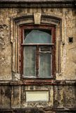 Old broken dirty window in the old house. Window in abandoned old house. Royalty Free Stock Photography