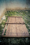 Old Broken Door on ground Stock Image