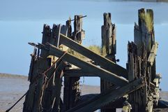 Old, broken down pier in the river usk, newport, gwent UK Royalty Free Stock Image