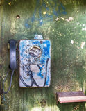 Old broken-down Soviet payphone. In rusty booth royalty free stock photography