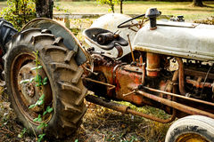 Old broken down tractor on a farm Stock Images