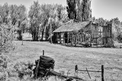 Old Broken Down Wooden Building. Abandoned broken down wooden farm building located inbetween Davis Creek and New Pine Creek, California, United States Stock Image