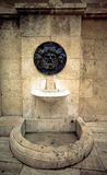 Old broken drinking fountain in the Spanish city Royalty Free Stock Image