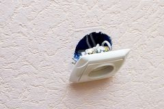 Old broken electrical socket fell out of wall.  Royalty Free Stock Images