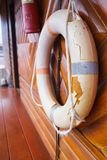Old, Broken and Expired Personal life support flotation safety device life buoy for swimmers, passengers or marine personnel. Working on boat or area exposed to stock photography