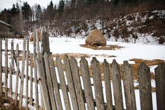 Old broken fence in the mountains in winter, haycock isolated Royalty Free Stock Images