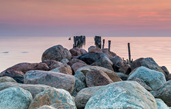 Old broken fishery pier at the Baltic sea Royalty Free Stock Photography