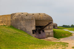 Old broken German bunkers of Atlantic Wall and artillery battery Stock Photo
