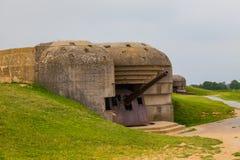 Old broken German bunkers of Atlantic Wall and artillery battery stock photo