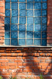 Old broken glass blocks in the brick walls Stock Photography