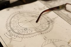 Old broken glasses on old and dirty blue prints for industrial manufacturing Stock Photography