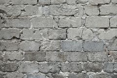 Old Broken Gray Brick Wall Background. Old Gray Damaged Brick Wall Texture, Gray Brick Backdrop And Texture For Text Or Image. Stock Photo