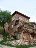Old and broken homes. Very old and broken homes, rock, green Royalty Free Stock Photo