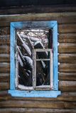 Old broken house in winter