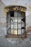 Old broken industrial window. Old window with broken panes on the wall of an industrial old building royalty free stock photography