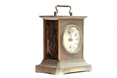 Old broken mantel clock on a white background Royalty Free Stock Images