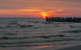 Old broken marine pier at dawn Stock Photos