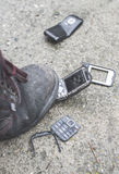 Old broken mobile phone. Boot crease phone stock image