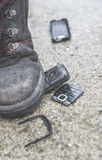 Old broken mobile phone. Boot crease phone royalty free stock photos