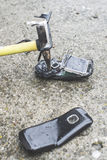 Old broken mobile phone. Hammer crease phone stock images