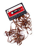 Old music cassette broken. Old broken music cassette with ribbon sticking out royalty free stock photos