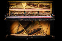 Old broken piano. Black background. Ukraine. Dnipro city art Stock Photo