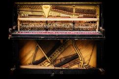 Old broken piano. Stock Photo