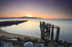 Old broken pier during awesoome beatiful sunset. Vibrant colour. Royalty Free Stock Images