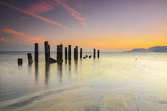Old broken pier during awesoome beatiful sunset. Vibrant colour Stock Images