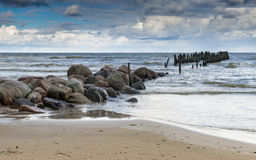 Old broken pier at the Baltic Sea, Ragaciems, Iatvia Royalty Free Stock Images