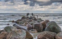 Old broken pier at the Baltic Sea, Ragaciems, Iatvia stock images