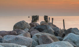 Old broken pier at dawn, Baltic Sea, Kurzeme, Latvia Royalty Free Stock Photo