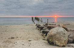 Old broken pier at dawn, Baltic Sea, Kurzeme, Latvia Stock Image