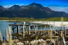 Old broken pier with misc stuff landscape background Stock Photos
