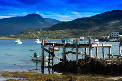Old broken pier with misc stuff landscape background Royalty Free Stock Photos