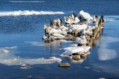 Old broken pier. In winter stock photos