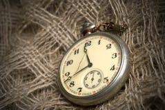 Old broken pocket watch on juta Royalty Free Stock Photo