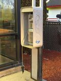 Old broken public pay phone stock images