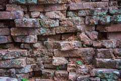 Old and broken red stone brick wall Stock Photography