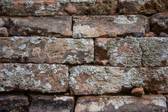 Old and broken red stone brick wall Stock Photos