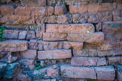 Old and broken red stone brick wall Royalty Free Stock Photography