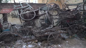 Old broken rickshaw bicycle for recycling in street, India Royalty Free Stock Images