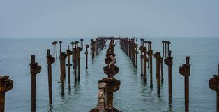 Old broken rusted iron piers royalty free stock photo