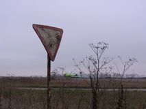 Old broken rusty road sign give salvage way in abandoned wasteland near airport royalty free stock photography