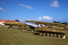 The old and broken, scratched Soviet Union rockets and armory, settled on Cuba, pointed out to the blue sky. Outdoors, copy space royalty free stock images